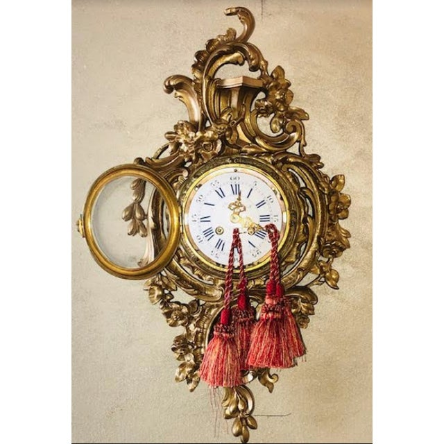 """Here is a 19th century cartel, or wall clock, is in the style of Louis XV Which measures 22-1/2 in height and 13"""" in..."""