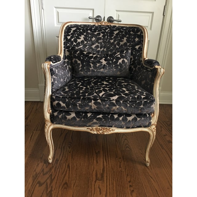 Schumacher French chair in a white wash finish with gold accent