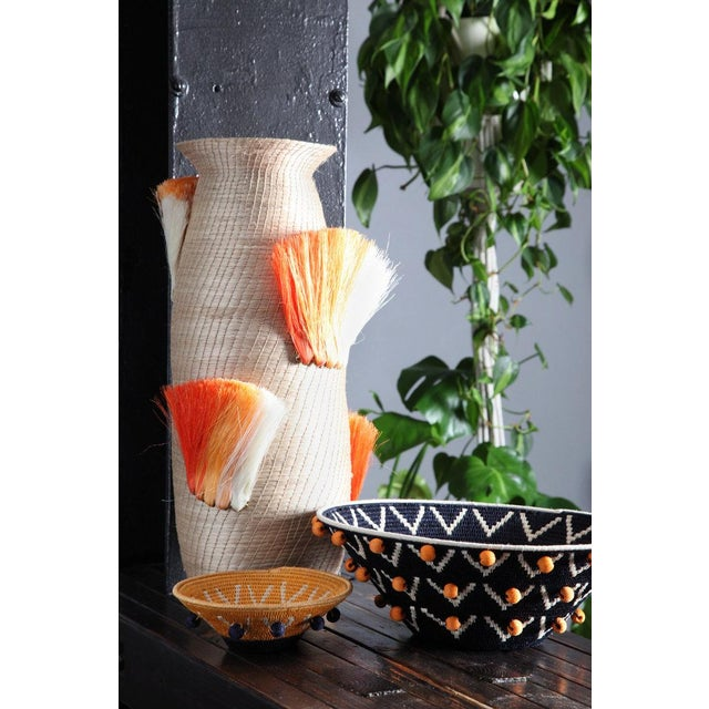Charlie Sprout Fanned Out vases are whimsical, fun, and hand crafted by women artisans in eSwatini, Africa. Woven from...