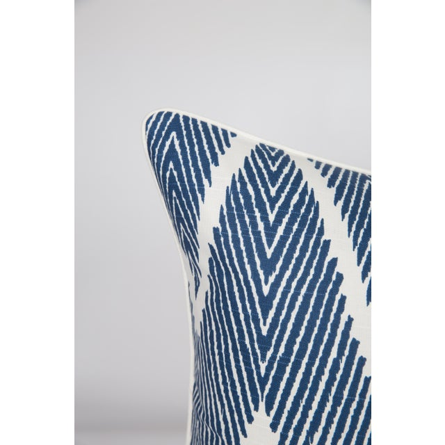 Pair of custom-tailored pillows in blue-and-ivory chevron pattern linen and cotton fabric. Solid neutral-colored ivory...