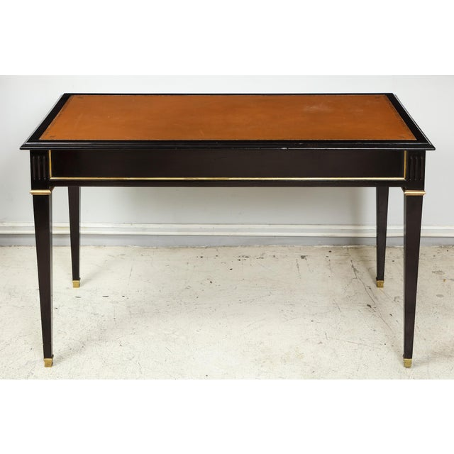 Ebonized leather-top bronze-mounted bureauplat desk on tapered legs ending in bronze sabots. This desk is finished on both...