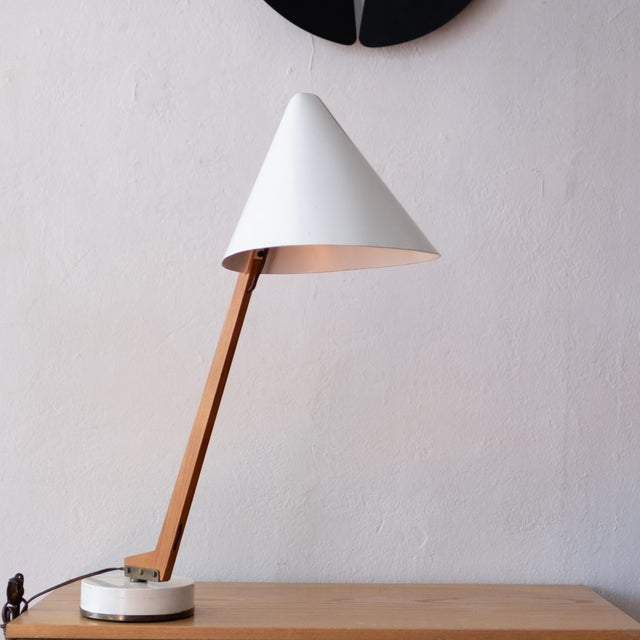 Model B 54 lamp by Hans-Agne Jakobsson for Markaryd. This architect's desk lamp has a metal shade, teak arm, brass...
