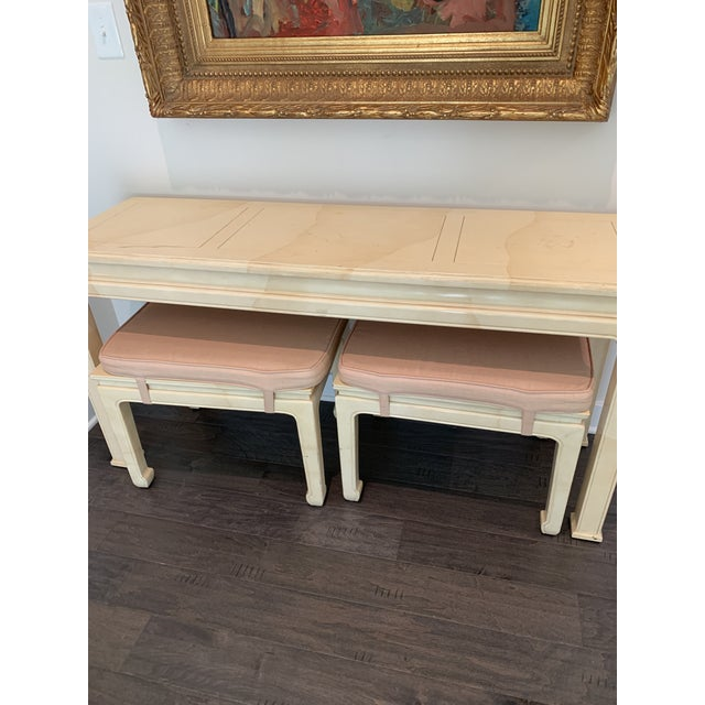 Awesome three-piece Henredon set. Faux goatskin Ming style console table with matching benches that nest underneath....