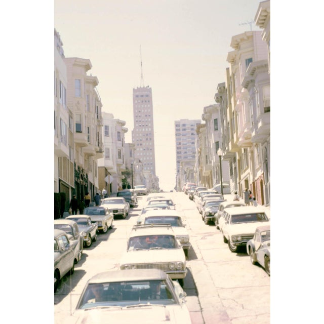 This 35mm film photograph was taken in the 1960s capturing one of the famous hilly streets of San Francisco. The Lyon +...