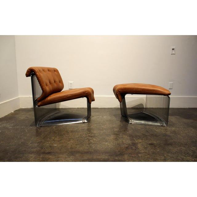 Rare Verner Panton for Fritz Hansen, Pantonova leather lounge chair and ottoman in original light-brown leather. Circa...