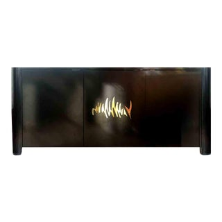 1970s Hollywood Regency Black and Gold Mirror Scribble Credenza For Sale