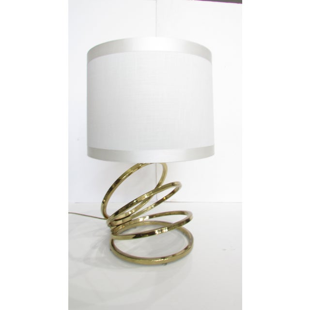 Unique and very glamorous table lamp. Base is a gold tone (probably brass plated). Shade is in decent shape.