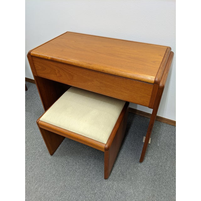 Really unique Danish teak vanity with mirror and matching stool. Notice the removable makeup trays. This is a really cute...