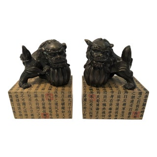Bronzed Chinese Foo Dogs on Calligraphy Plinths - a Pair For Sale