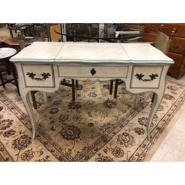 This vanity was manufactured by John Widdicomb in Grand Rapids, Michigan, marked inside the left drawer. Likely produced...