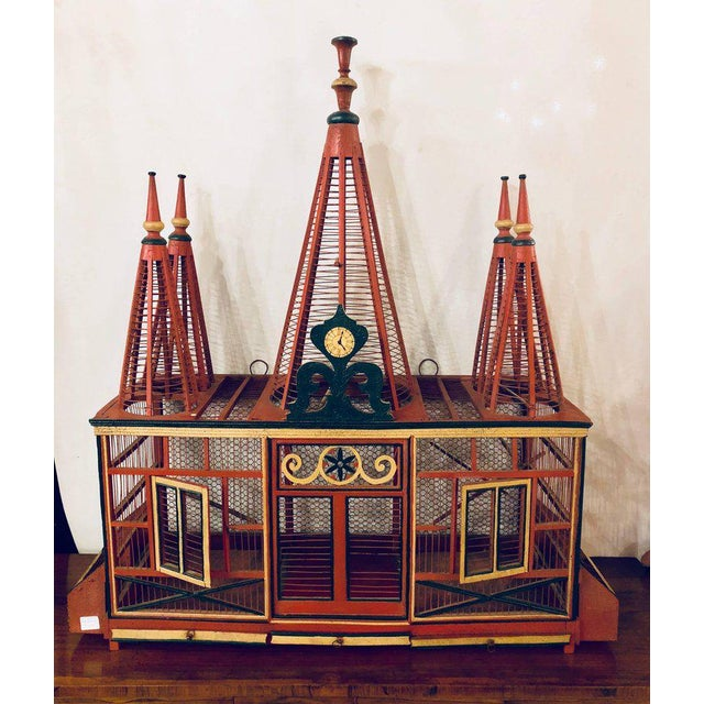 An Americana Folk Art original painted bird cage. In bright vibrant original paint comes this circus tent formed bird cage.