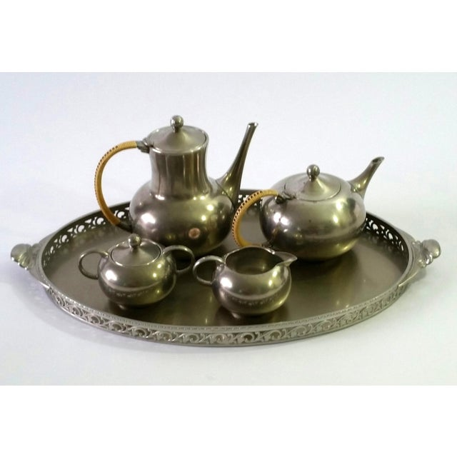 This Item consists of a vintage five piece pewter tea serving set, including a teapot, hot water pitcher, creamer, sugar...