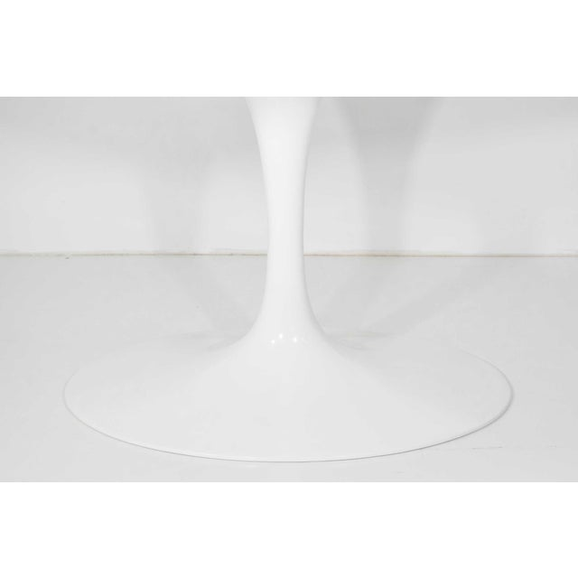 "This table is 78"" oval with a white laminate top. Has the Knoll studio stamp."