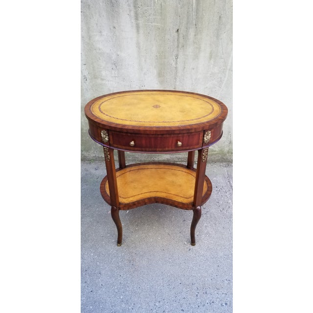 Beautiful Maitland-Smith 2 tiers kidney shape side table with a single draw in a light Mahogany wood finish.Both shelves...