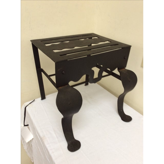 Antique footman or kettle stand in blackened steel. Great as a small step or as an little side table or an accent piece...