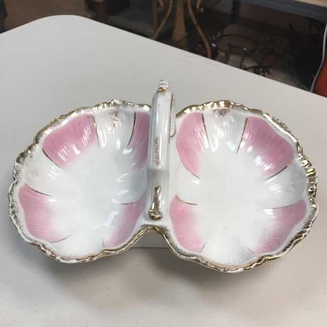 Stunning porcelain double serving bowl from KPM Porcelain. Beautiful gold and petal pink accents. Scalloped edge. This...