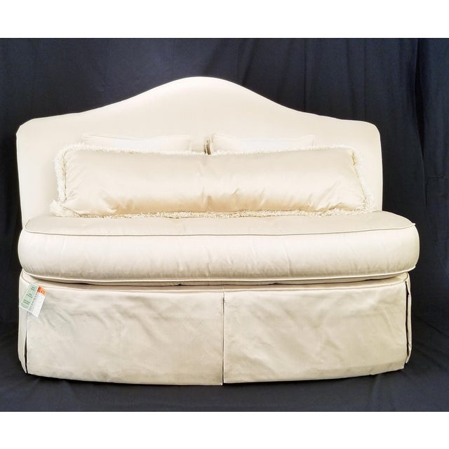 """New with tags is an armless Charlotte Settee. The Settee is covered in taupe silk like fabric. 46"""" tall at highest point."""