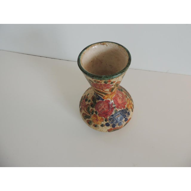 Small Floral Deruta floral painted vase. Floral design all around and signed. In shades of blue, pink, green and yellow....