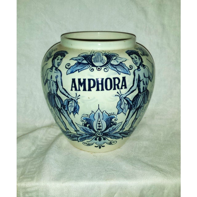 "Blue Delft ""Amphora"" Jar. With hand painted decoration of islanders and florals. Creamy porcelain with gorgeous blue..."