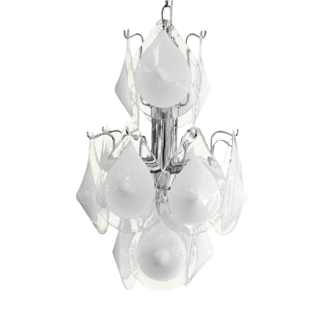 Mid-century modern Vistosi chandelier (circa 1960s-1970s) accommodates five candelabra-size bulbs. Newly-wired for use...