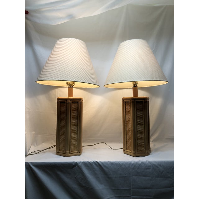 Exceptional set of two wicker and rattan table lamps from the 1960s in superb condition. These lamps have fading light...
