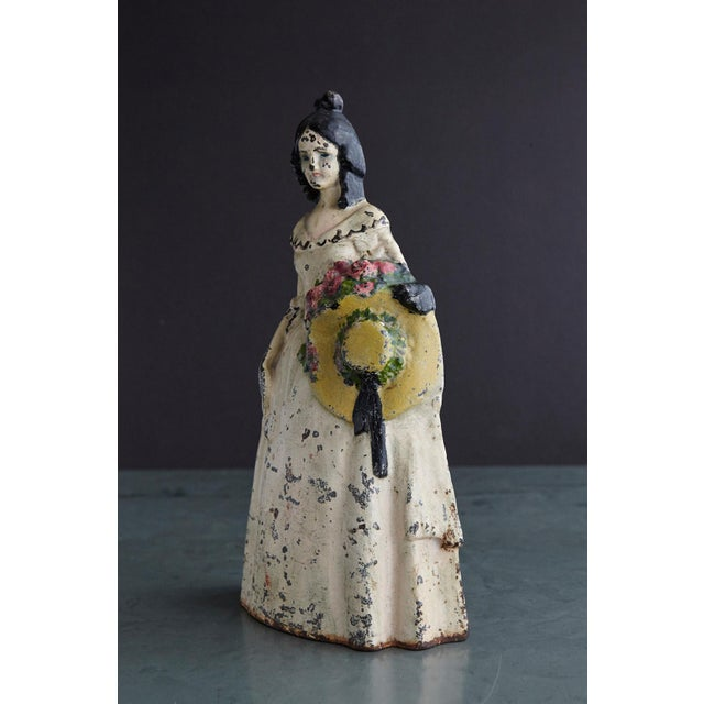 Lovely late 19th century large cast iron hand painted polychrome woman with straw hat doorstop with it's original paint...
