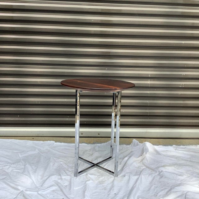 Handsome drinks table with solid rosewood top and X chrome base. Unknown maker, but good quality. Sophisticated, and a...