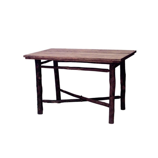 American rustic old hickory dining table with rectangular oak plank top and legs joined by an X-stretcher. Since 1899 Old...