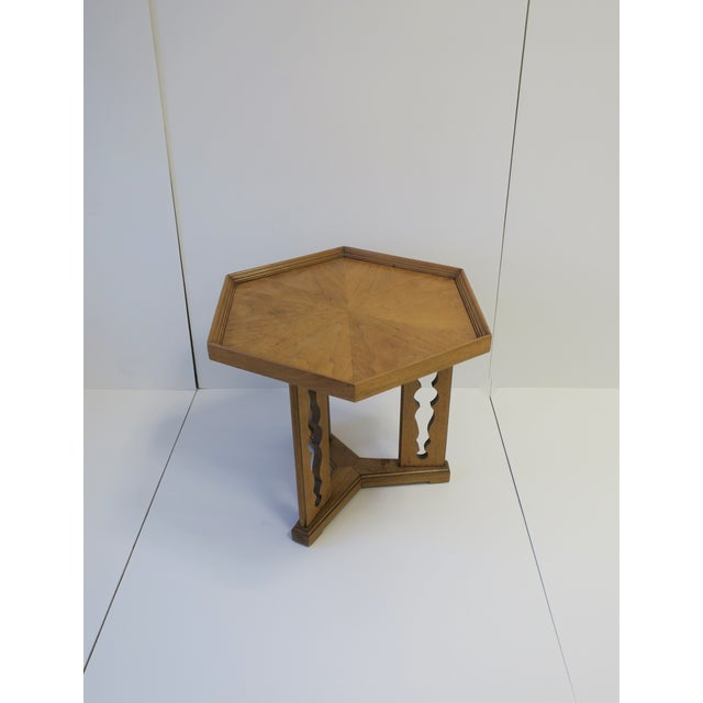 A hexagon top wood side or end table 'Esperanto' by Drexel with decorative base. The hexagon shape tabletop is a nice...