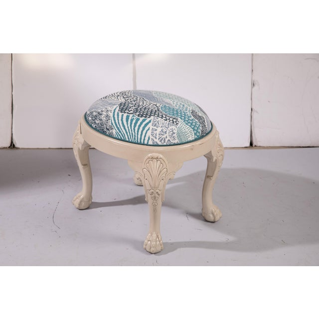 Traditional claw-footed carved wood stool upholstered in Madcap Cottage Windsor Park fabric in indigo with contrast blue...