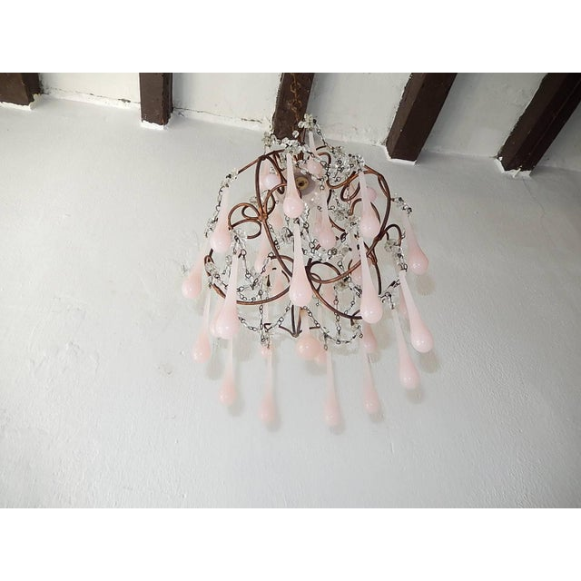 Rewired and ready to hang. Housing one light in center under a pink opaline bobeche. Swags of macaroni beads and florets...