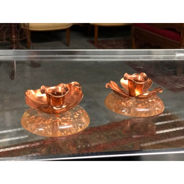 Lovely pair of candle holders with copper floral decorations resting on round bases with rose gold foil specs cast in...