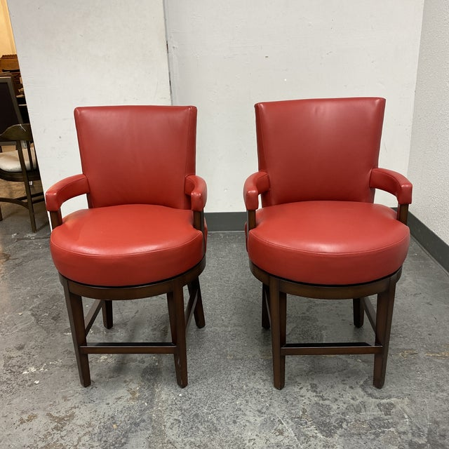 Design Plus Gallery presents a pair of Wheeler Design Group Counter Stools. Meticulously hand crafted Chestnut stained...
