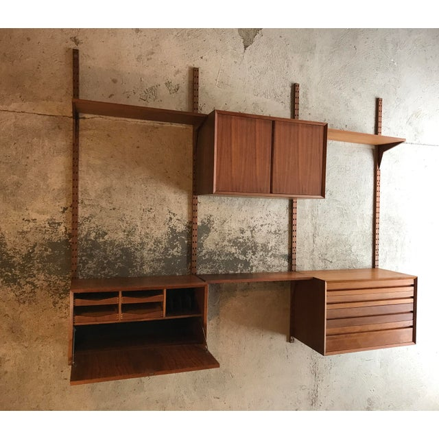 "Poul Cadovius teak cado wall unit. Unit is very good condition, with minor wear. Includes: 4 Uprights 79 3/4""high 3 Shelfs..."
