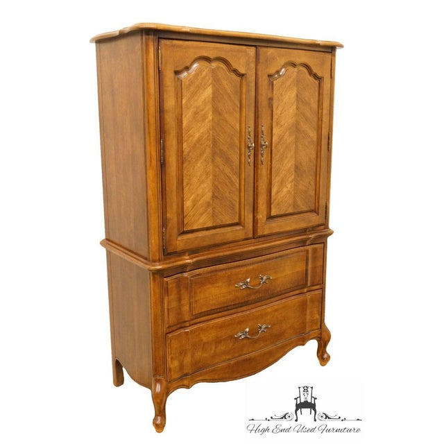 This is a vintage Stanley Furniture armoire from the late 20th century. This piece would look great in a French country home.