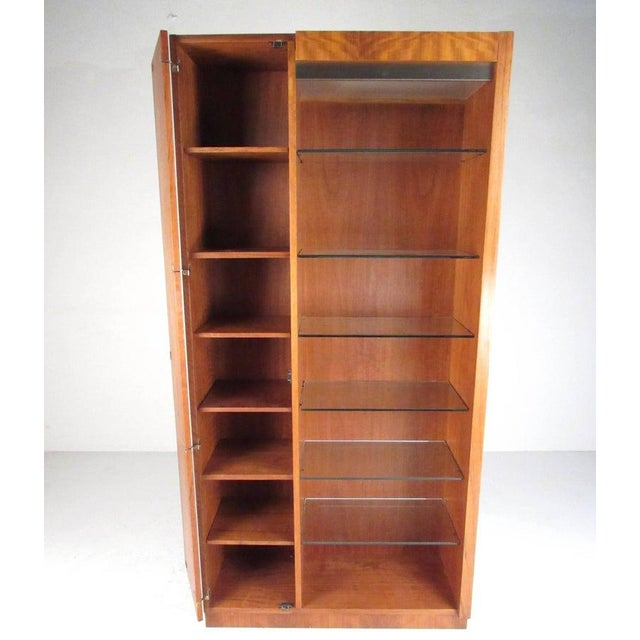 This statuesque pair of tall teak cabinets feature Scandinavian Modern style and quality craftsmanship. Top lit glass...