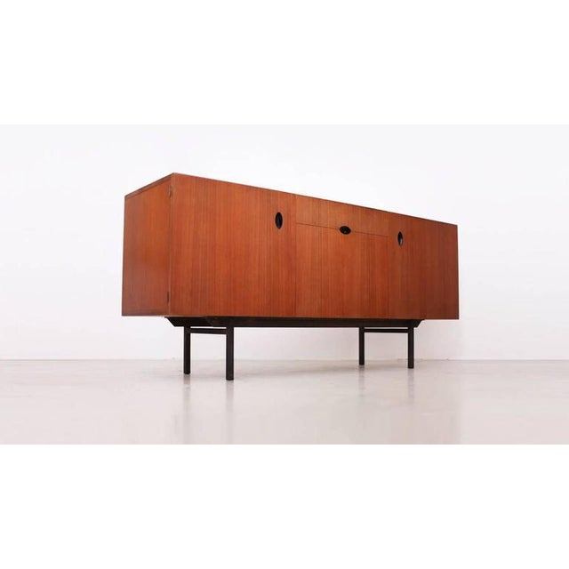 Paul Geoffroy sideboard for Bobois in teak in excellent condition. The handles are very unique and give this square shape...