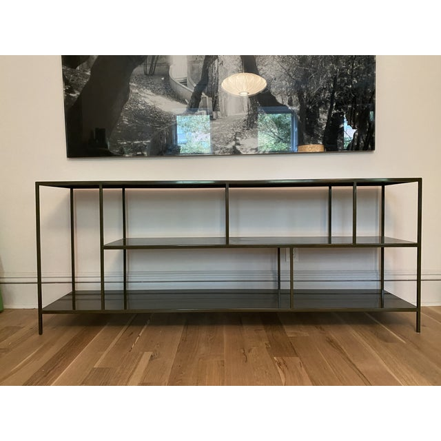Durable steel combined with elegant simplicity of minimal design and clean, modern details, this piece from the Foshay...