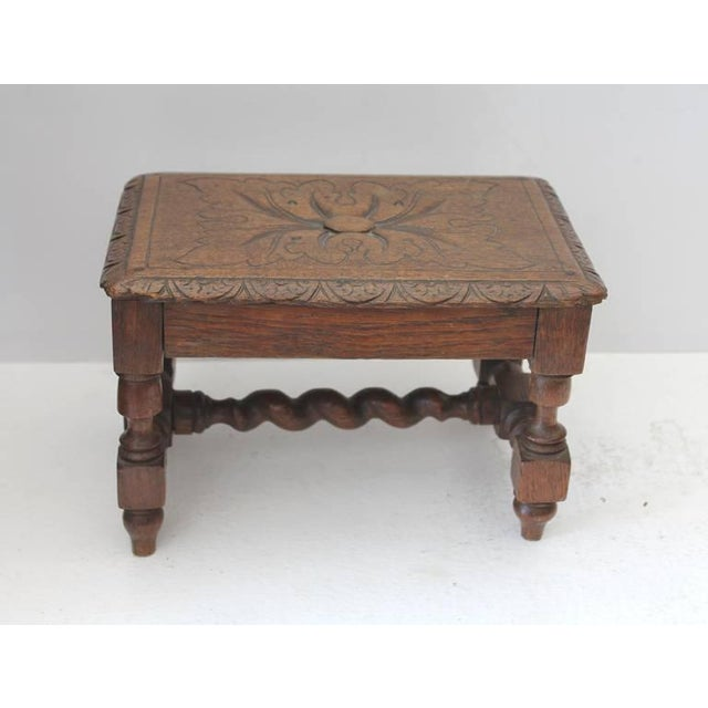 This hand carved and very detailed cricket or foot stool is in wonderful as found condition.This small foot stool has so...