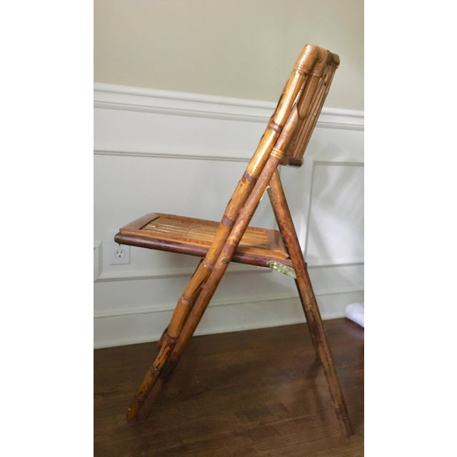 This sturdy vintage bamboo folding chair has a lacquered tortoise shell finish and provided a stylish extra seat, or ideal...
