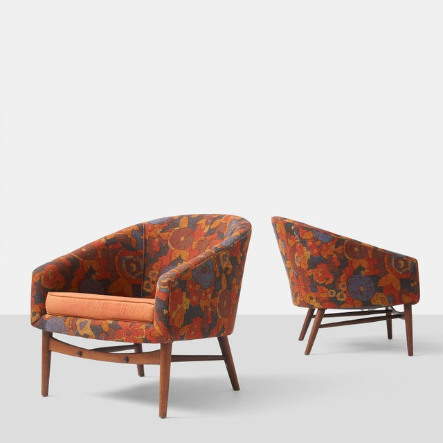 "Designed in the style of Lawrence Peabody for Selig, a pair of lounge chairs with tapered walnut legs and ""U"" backs which..."