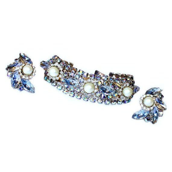 c.1950/60s dazzling silvertone bracelet and clip back earrings prong set with pale ice blue faceted marquis stones, round...