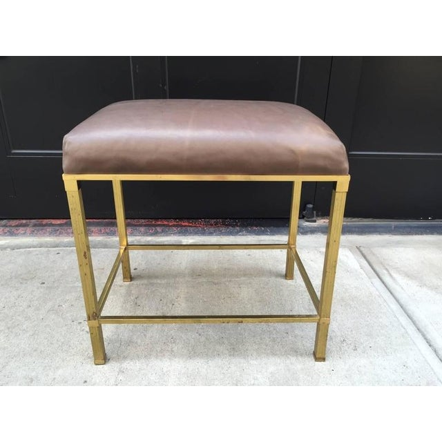 Brass Directoire style bench with leather seat.
