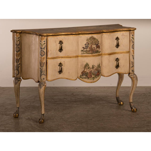 Antique Italian Baroque Painted Two Drawer Chest, circa 1750. The softly undulating facade of this chest that stands upon...
