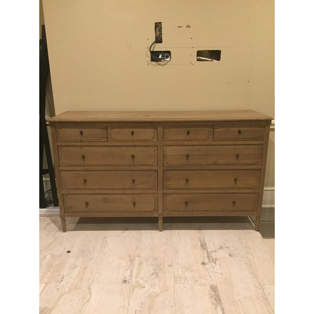 Restoration Hardware dresser with raised-panel drawers, turned legs, fluted stiles and hand-carved corner blocks with...
