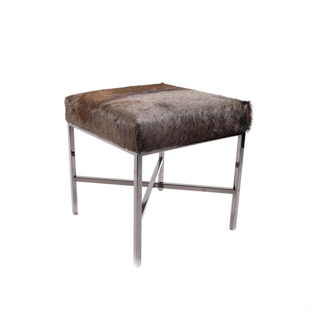 A black chrome and wildebeest upholstered bench. Made in Canada