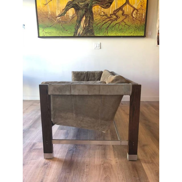Jack Cartwright's sling loveseat simple as well as an intriguing piece of furniture. The frame consisting of Brazilian...