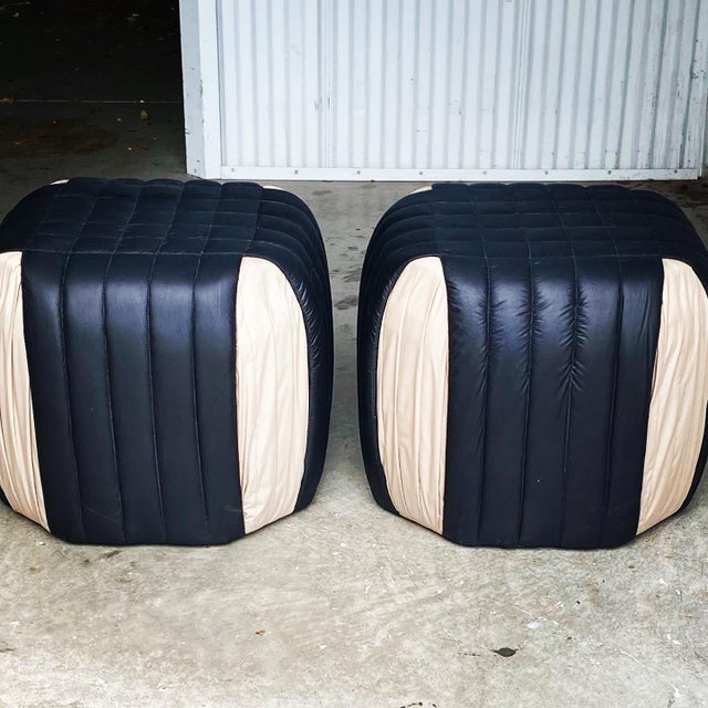 Fabulous pair of quilted ottomans. Done in a quilted Cotten sateen in shades of black and ecru. A really contemporary look...