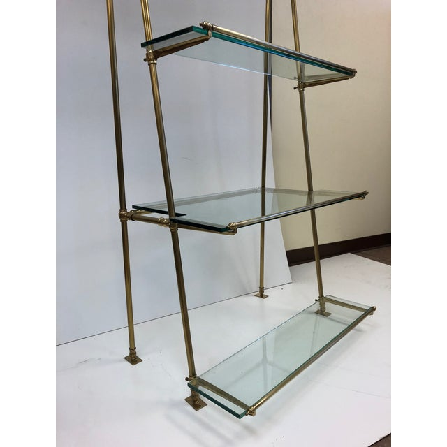 1950s French bronze wall-mounted and freestanding Etagere with glass shelves. Has four glass shelves. Can be mounted to...