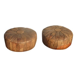 Pair of Vintage French Country Rustic Leather Ottomans W Pair Vintage French Country Rustic Leather Ottomans W Embossed Leather Figures For Sale